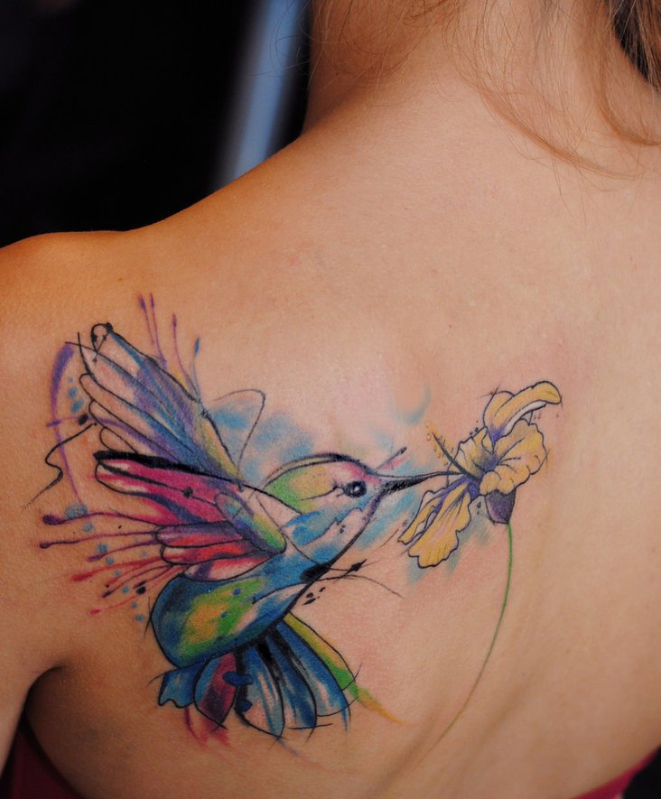 Lovely Watercolor Hummingbird And Flower Tattoo On Back Shoulder
