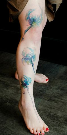 Lovely Watercolor Tattoos On Leg