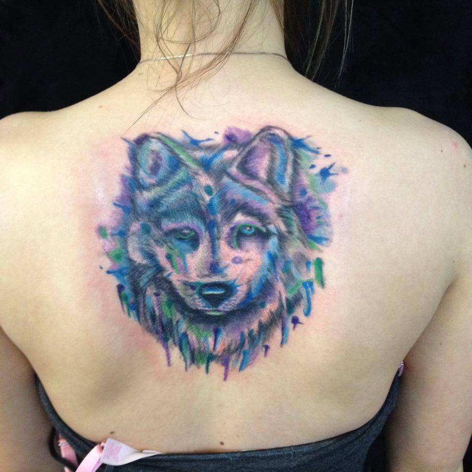 Lovely Watercolor Wolf Tattoo On Upperback