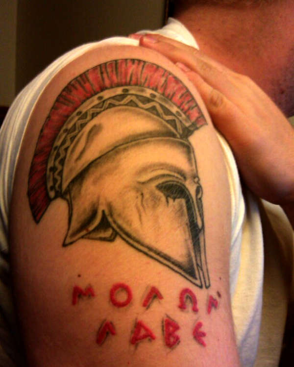 Man Shows His Spartan Helmet Tattoo