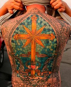 Man Shows Off Full Back Stained Glass Cross Tattoo