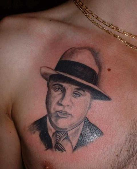 Man Wearing Hat Portrait Tattoo On Chest