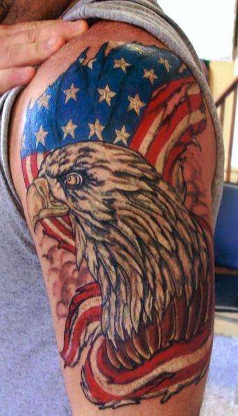 Man With American Tattoos On Half Sleeve