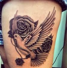 Marvelous Pigeon And Rose Tattoos On Thigh