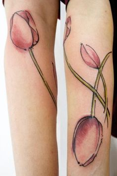 Matching Tulips Tattoos Of Sisters