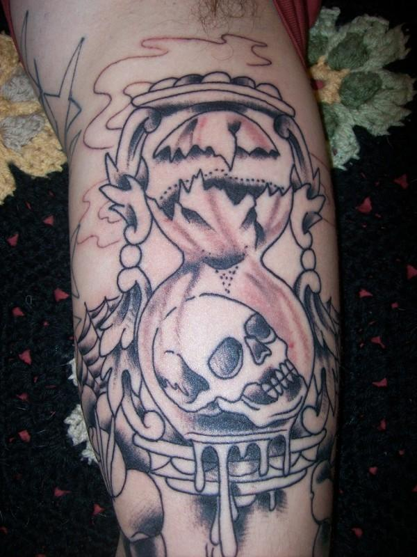 Melting Skull Hourglass Tattoo