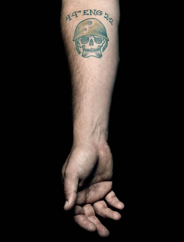 Memorial Skull Helmet Tattoo On Forearm