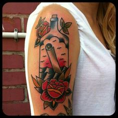 Message In Bottle With Flower Tattoos On Arm
