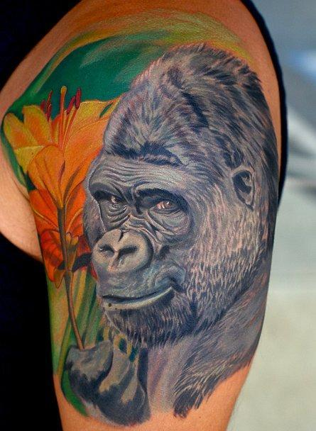 Mind Blowing Gorilla Portrait Tattoo On Biceps