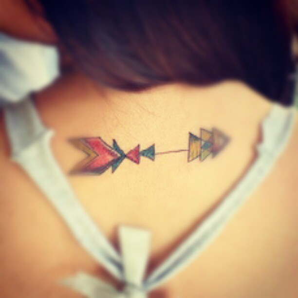 Multi Colored Arrow Tattoo On Upperback