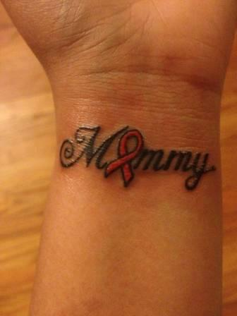 Mummy Word With Cancer Ribbon Tattoo On Wrist