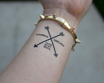 Name And Black Crossed Arrow Tattoos On Wrist