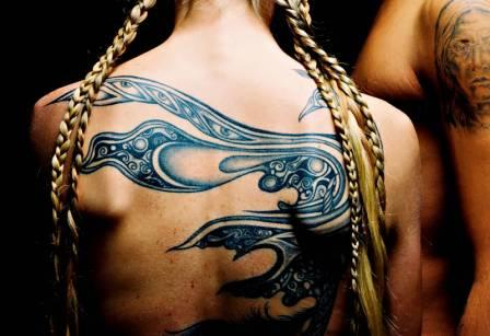 Native American Tribal Tattoo On Backbody