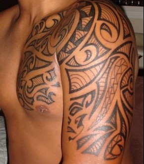 Native American Tribal Tattoo On Chest And Half Sleeve