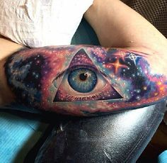 New Galaxy And Pryamid With Eye Tattoos On Inner Arm