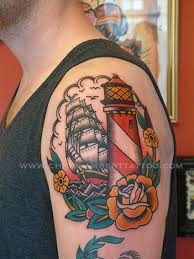 New Ship Lighthouse And Flower Tattoos On Shoulder