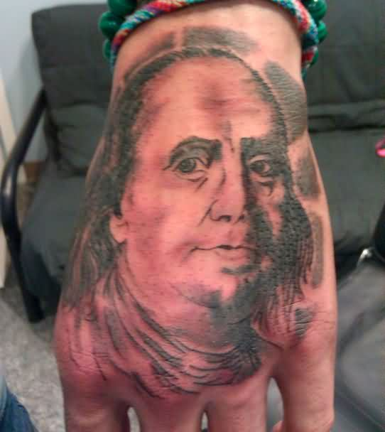 Nice Ben Franklin Portrait Tattoo On Hand