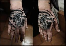 Nice Crow Face Portrait Tattoo On hand