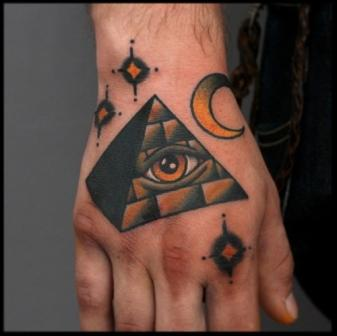 Nice Eye Pyramid Moon And Star Tattoos On Hand