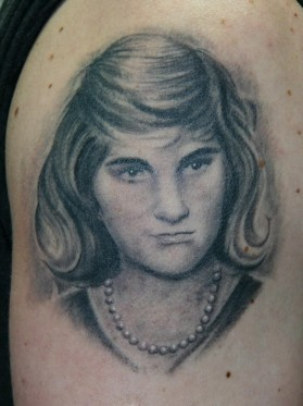 Nice Girl Portrait Tattoo On Biceps