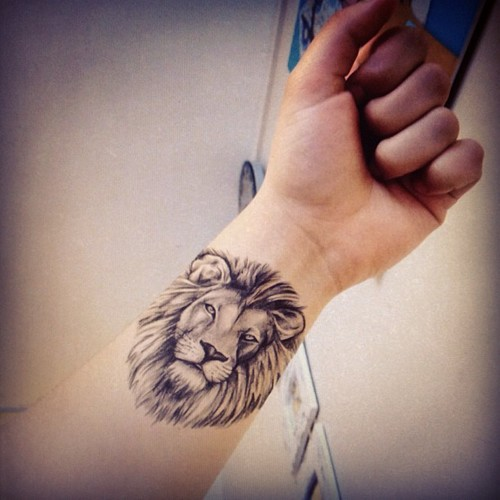 Nice Grey Animal Head Tattoo On Wrist