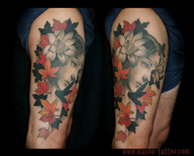 Nice Grey Girl Portrait And Leafs Tattoos On Thigh