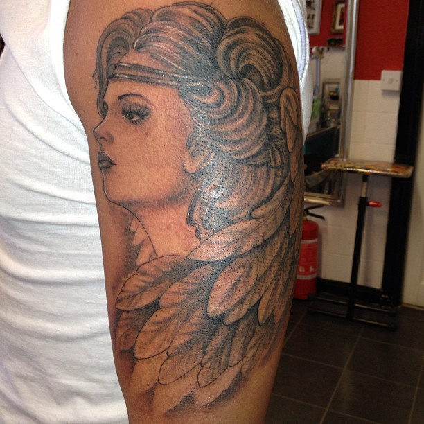 Nice Grey Ink Angel Portrait Tattoo On Arm