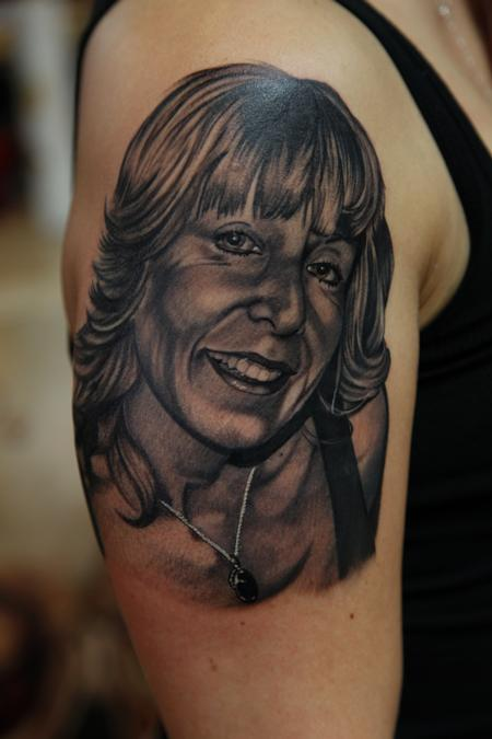 Nice Smiling Lady Portrait Tattoo On Biceps