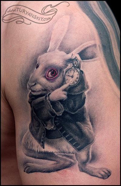 Nice White Rabbit Portrait Tattoo On Biceps