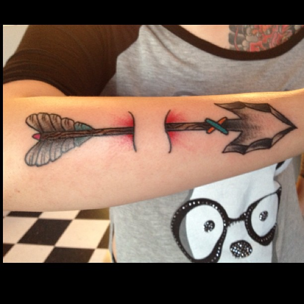 Old Arrow Ripped Skin Tattoo