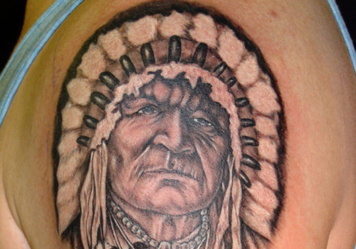 Old Indian Portrait Tattoo On Shoulder