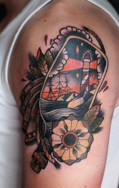 Old School Lighthouse Bottle Tattoo With Flower On Arm