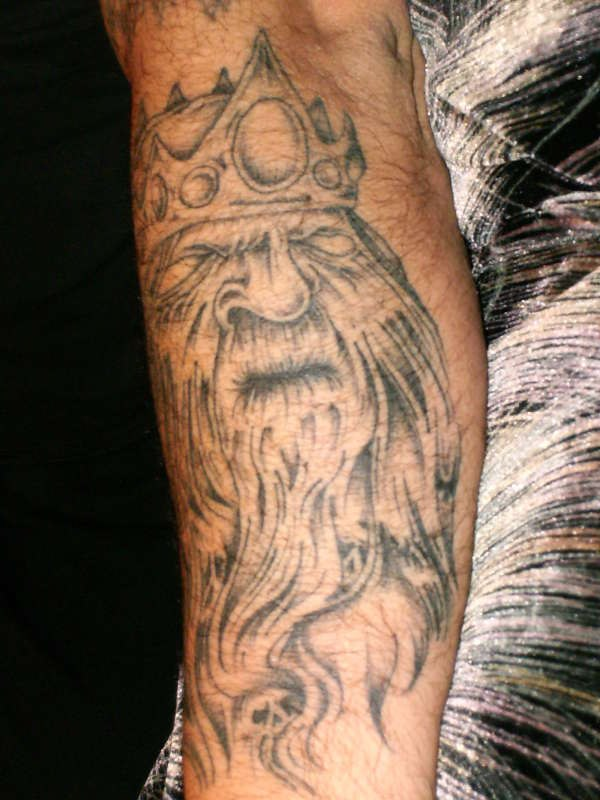Old Viking Head In Helmet Tattoo On Arm