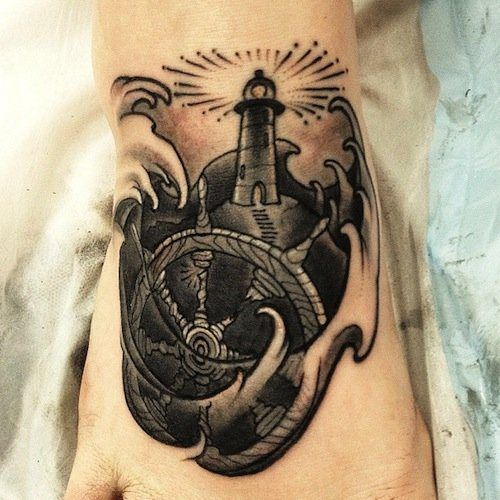 Old Wheel And Lighthouse Tattoos On Foot