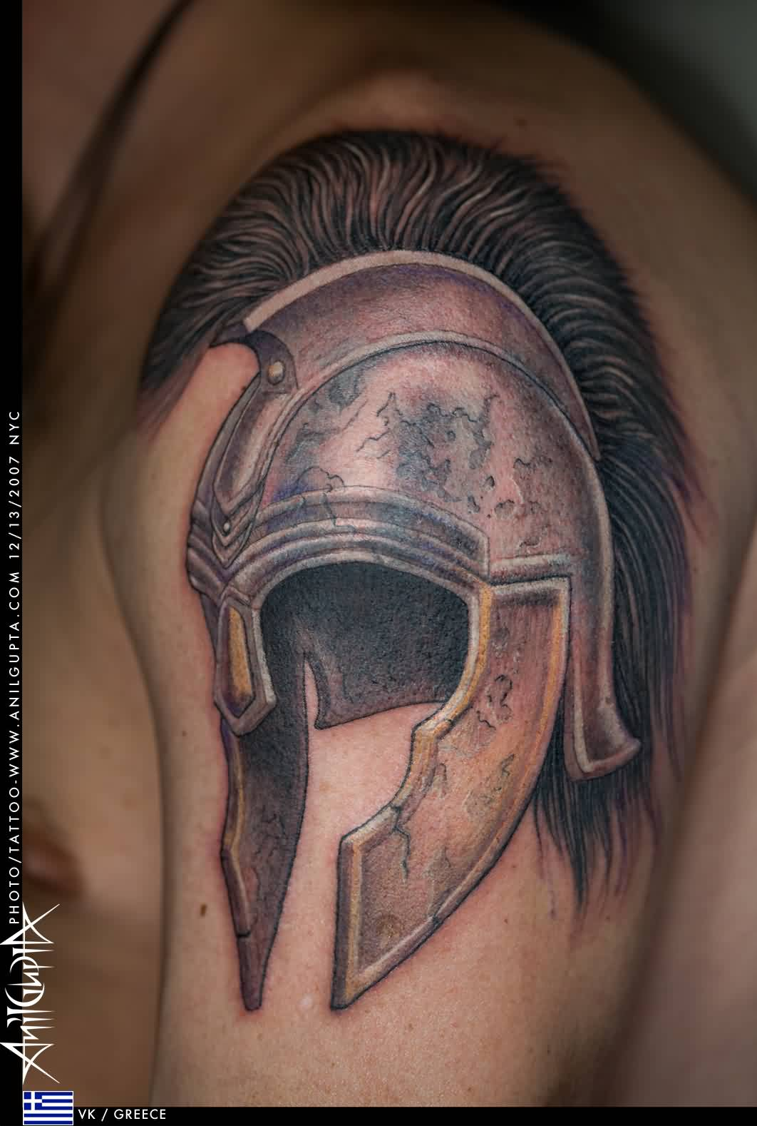 Oustanding Warrior's Helmet Tattoo On Biceps