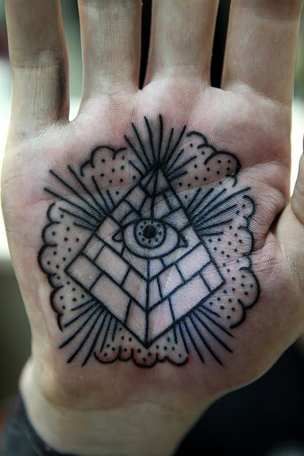 Outline Clouds And Eye Pyramid Tattoos On Palm