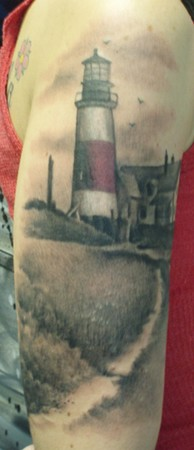 Outstanding Lighthouse Tattoo On Biceps