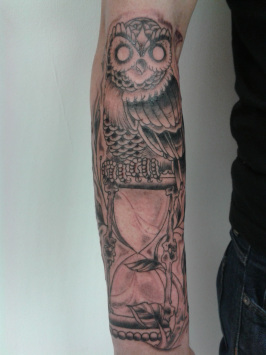 Owl Sitting On Hour Glass Tattoo On Sleeve