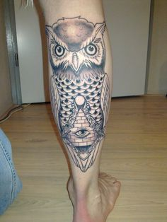 Owl With Eye Pyramid Tattoo On Back Leg