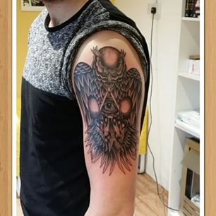 Owl With Eye Pyramid Tattoo On Biceps