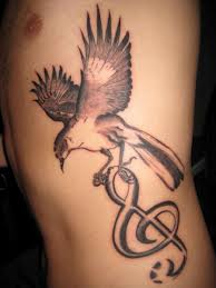 Pigeon With Music Note Tattoo On Ribs