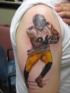Player Wearing Helmet Tattoo On Biceps