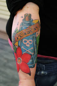 Poison Bottle With Flower Tattoo On Lower Arm