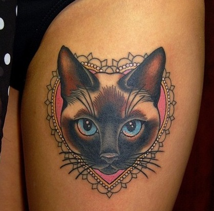 Pretty Animal Heart Frame Tattoo On Thigh