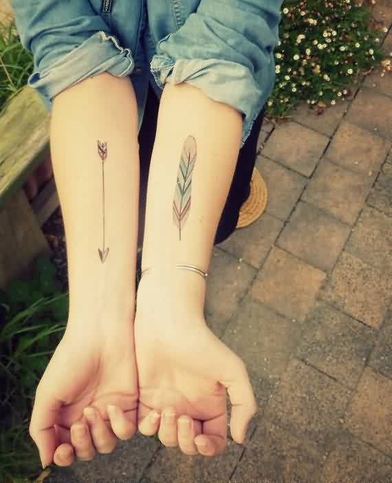 Pretty Arrow And Feather Tattoos On Forearms