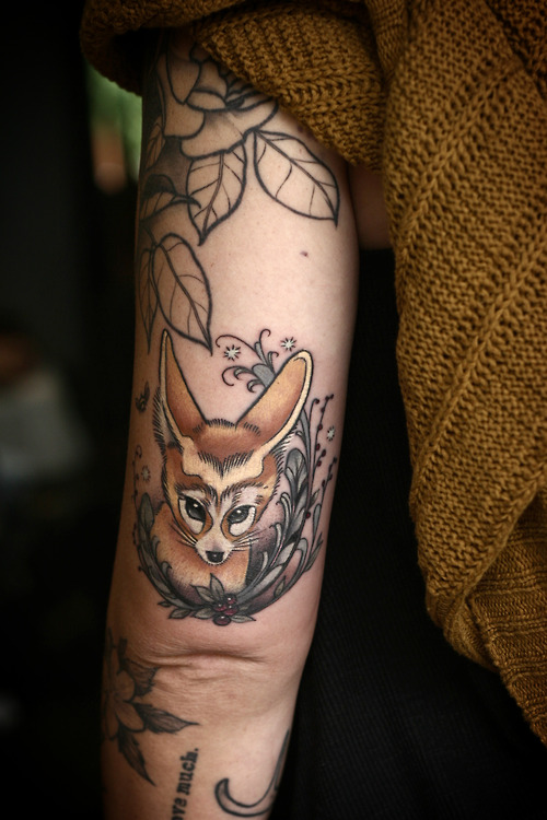 Pretty Flower And Animal Tattoos On Arm