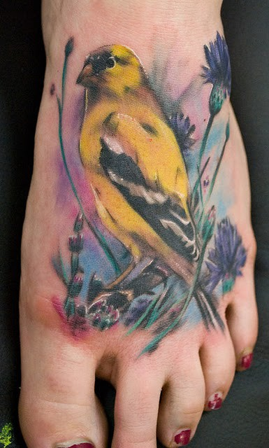 Pretty Watercolor Bird Sitting On Branch Tattoo On Foot
