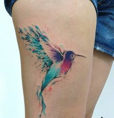 Pretty Watercolor Bird Tattoo On Thigh