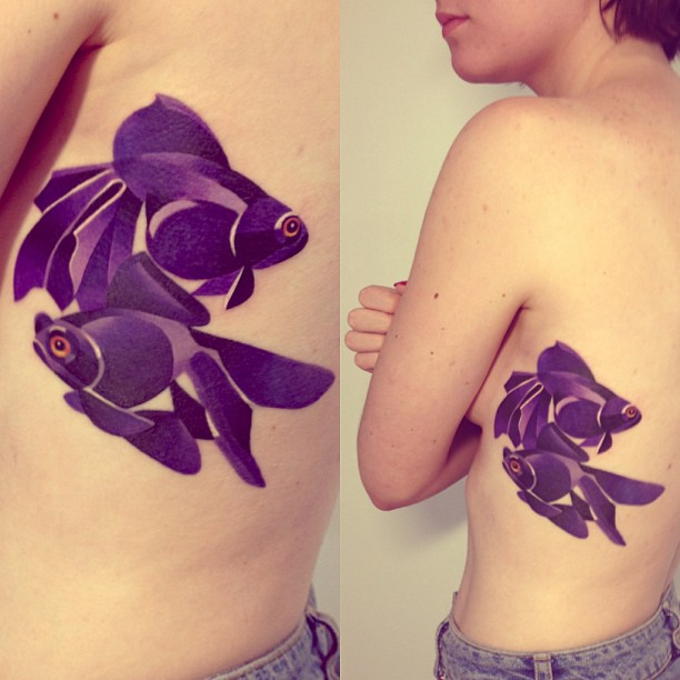 Pretty Watercolor Fish Tattoos On Ribs