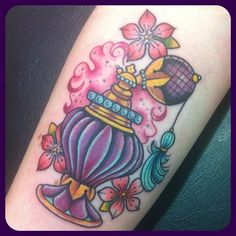 Purple Perfume Bottle Tattoo With Flowers